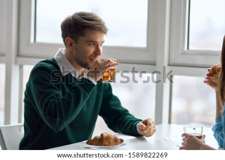 Man and woman in cafe chatting dating breakfast #1589822269