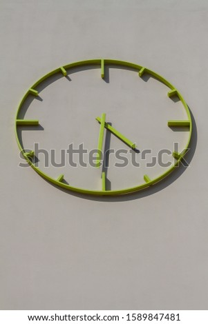 A modern building with a modern clock #1589847481