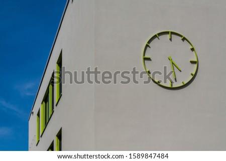 A modern building with a modern clock #1589847484