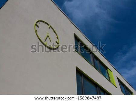 A modern building with a modern clock #1589847487