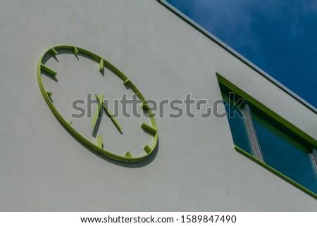 A modern building with a modern clock #1589847490