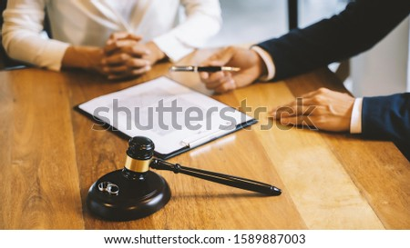 Divorce agreement. Lawyer Consultant with customer in courtroom. #1589887003