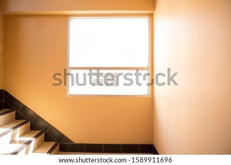 The window between the stairs of the dormitory #1589911696