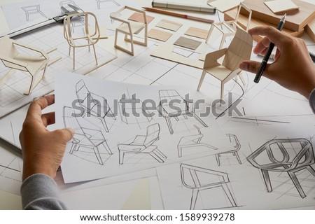 Designer sketching drawing design development product plan draft chair armchair Wingback Interior furniture prototype manufacturing production. designer studio concept .                            #1589939278