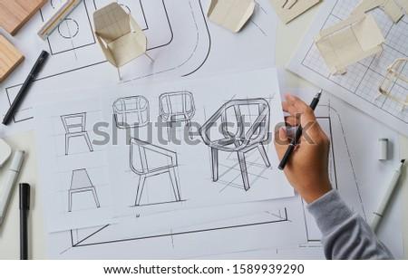 Designer sketching drawing design development product plan draft chair armchair Wingback Interior furniture prototype manufacturing production. designer studio concept .                            #1589939290