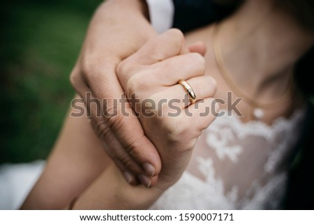wedding ring of the bride holding hands with the groom #1590007171