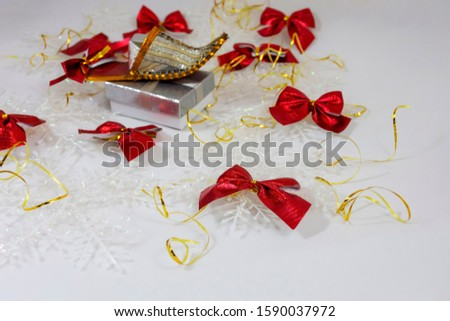 red bow on the background of gift boxes and several bows closeup isolate on a white background #1590037972