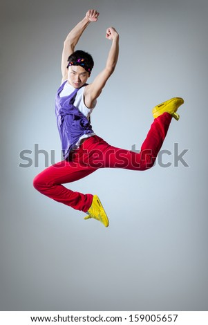 young beautiful dancer posing on a studio background #159005657