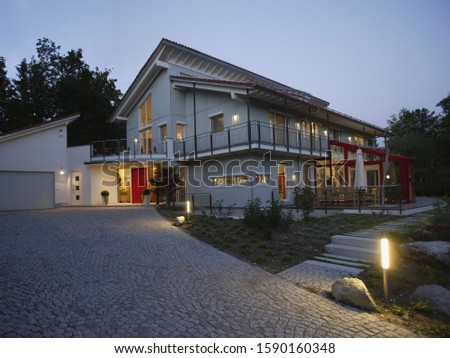 Exterior of residential house at night #1590160348