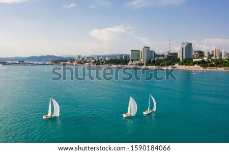 Sea regatta ships. Yacht in the sea. Teamwork. The speed of the wind. Aerial photography photos. Sailboat. The captain and crew. The view from the top. A sailing yacht. #1590184066