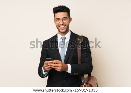 Young handsome businessman man over isolated background #1590191335