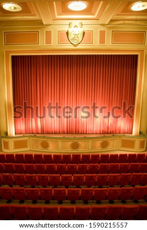 Seating and stage in empty theater #1590215557