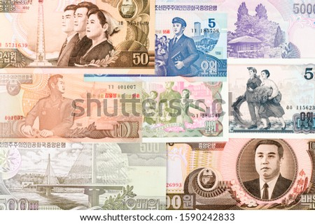 North Korea Won banknotes background. High resolution vintage photo of North Korean bill 5, DPRK money close-up macro.