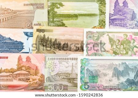 North Korea Won banknotes background. High resolution vintage photo of North Korean bill 4, DPRK money close-up macro.