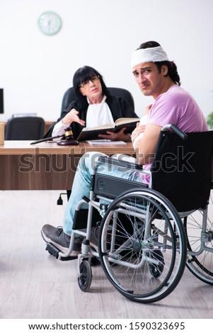 Disabled man consulting judge for damages litigation #1590323695