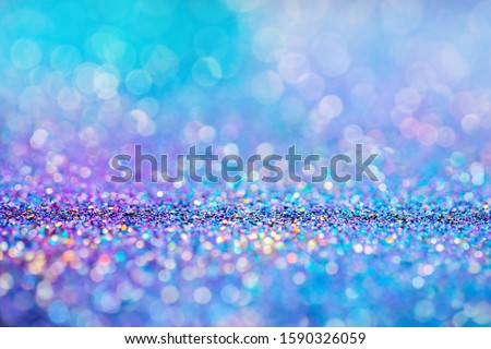 Shiny multicolor glitter raster background. Abstract shimmering pink, blue, yellow circles decorative backdrop. Bokeh lights effect illustration. Overlapping glowing and twinkling spots