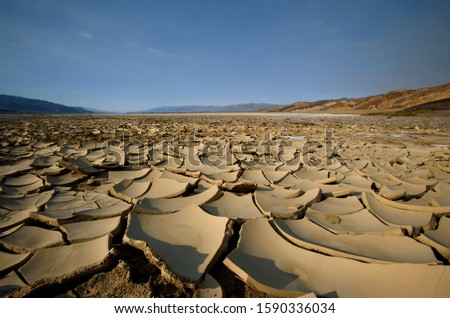 Cracked desert earth with crust of salt, Death Valley National Park, Nevada, U #1590336034