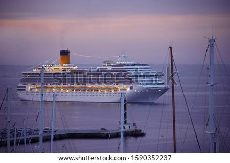 Cruise Ship arriving at the harbor of Palma de Mallorca at sunrise, Mallorca, Spain #1590352237