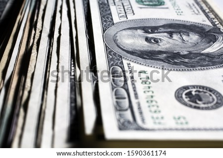 Stack of US paper currency #1590361174