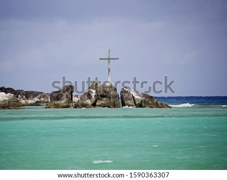 Crucifix on rock formation, Port Launay Marine National Park, Mahe', Seychelles #1590363307
