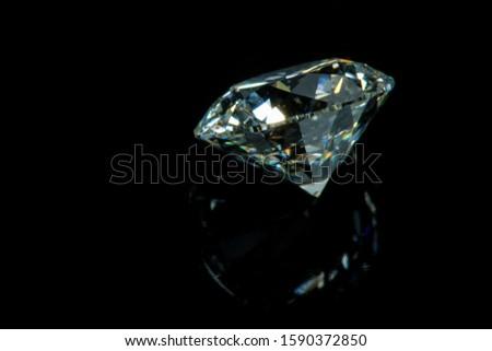 Side Profile Of Round Brilliant Loose Diamond Isolated On Black Background, Focused On Facets Of Diamond Girdle