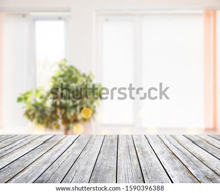 Blurred background with vintage wooden table #1590396388