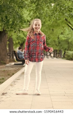 Hairstyles to wear on windy days. Windproof hairstyles. Girl little cute child enjoy walk on windy day nature background. Feeling cozy and comfortable on windy day. Deal with long hair on windy day. #1590416443