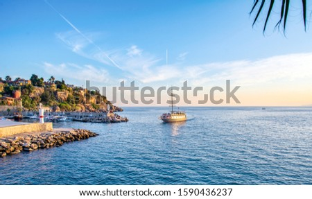 Antalya / Turkey  December 14, 2019: Beautiful view  Sailing boats silhouetted by sunset light in harbor of Antalya Kaleiçi Old town (Kaleici) in Antalya, Turkey #1590436237