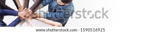 Multicultural hands synergy brainstorm business man woman in circle top view background. Support helping teamwork together international diversity harmony education and people concept panoramic banner #1590516925