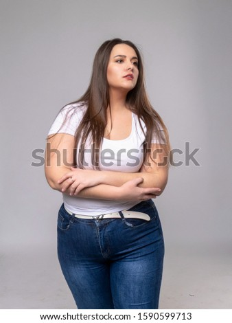 Plus Size Model in studio. Something looking, peeking out because of an obstructing subject #1590599713