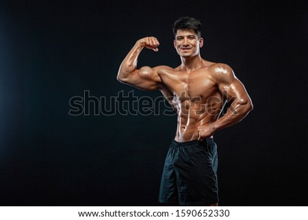 Athlete bodybuilder. Strong and fit man. Sporty muscular guy on black background. Sport and fitness motivation. Individual sports recreation. #1590652330