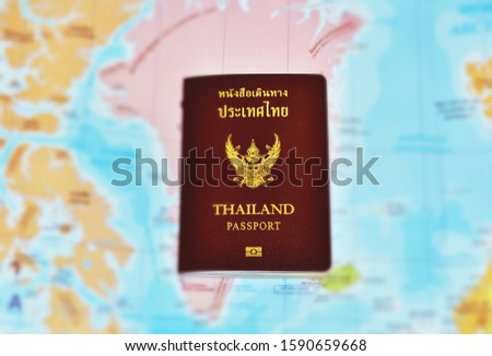 planning travel concept,Thailand passport on blue map - image  #1590659668