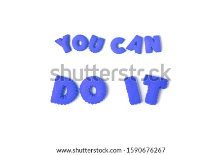 The word YOU CAN DO IT spelled with blue alphabet shaped cookies on white background #1590676267