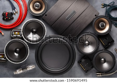 car audio, car speakers, subwoofer and accessories for tuning. Dark background. Top view. #1590691495