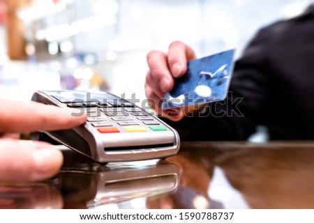 Payment by card, in the payment terminal. Electronic money. Mobile banking. Shopping complex #1590788737