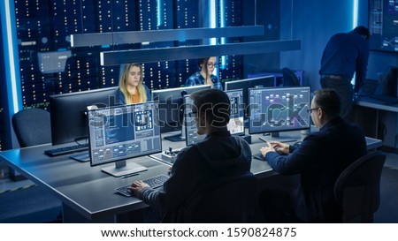 Team of IT Programers Working on Desktop Computers in Data Center System Control Room. Team of Young Professionals Working In Software and Hardware Development, Doing Coding #1590824875