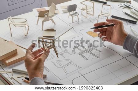 Designer sketching drawing design development product plan draft chair armchair Wingback Interior furniture prototype manufacturing production. designer studio concept .                            #1590825403