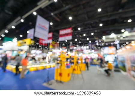Abstract blur people in exhibition hall event trade show expo background. Large international exhibition, convention center, Business marketing and MICE industry concept. #1590899458