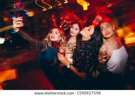 Group of friends at club making selfie and having fun  #1590927598