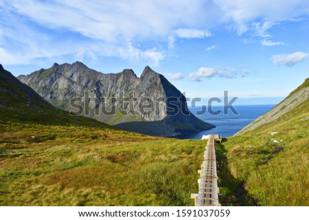 Wooden path in mountains near Kvalvika beach #1591037059