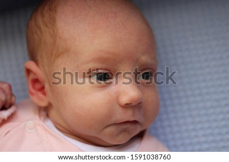 Little baby girl lies on the blanket and looks uo to camera and she poses in different poses #1591038760