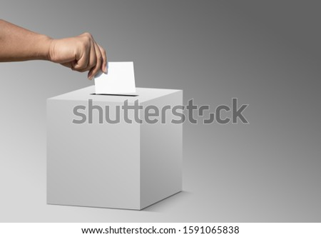 concept vote election Election of members of parliament, president, chief, executive. a ballot paper in hand isolated with clipping path on background #1591065838