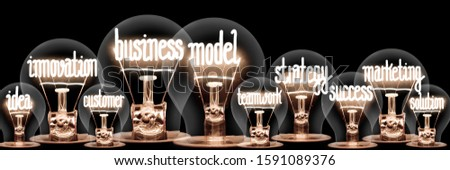 Photo of light bulbs with shining fibers in a shape of Business Model, Innovation, Strategy and Marketing concept related words isolated on black background #1591089376