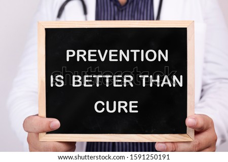 Prevention is better than cure. Male doctor holds chalkboard with health typography quotes written on it. Health and Medical Concept Royalty-Free Stock Photo #1591250191