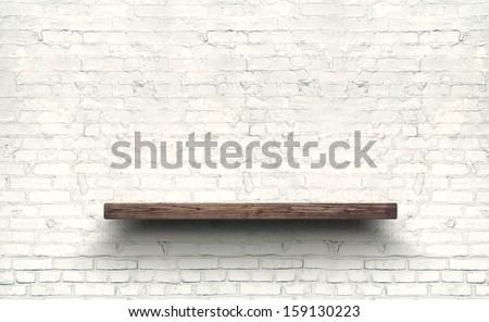 Wood shelf on brick wall texture background. Royalty-Free Stock Photo #159130223