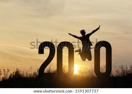 Freedom Silhouette woman and 2020.Concept of a new year. #1591307737