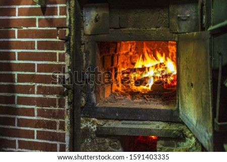old fireplace. woods in fireplace in the village on Autumn. #1591403335