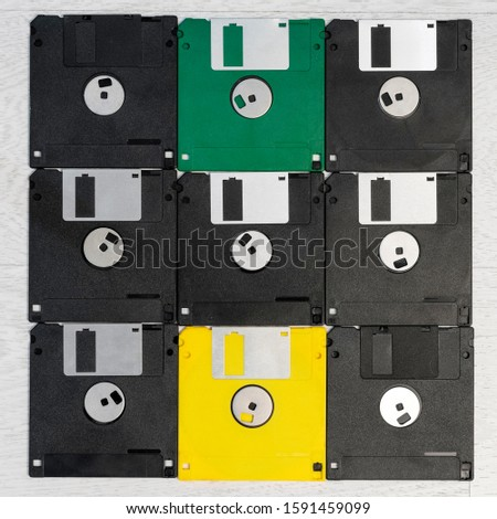 Old floppy disks are arranged in a square shape. #1591459099