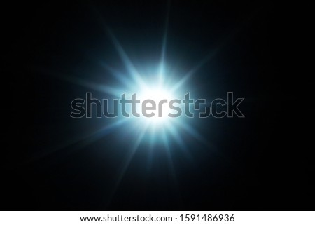 Easy to add lens flare effects for overlay designs or screen blending mode to make high-quality images. Abstract sun burst, digital flare, iridescent glare over black background. #1591486936