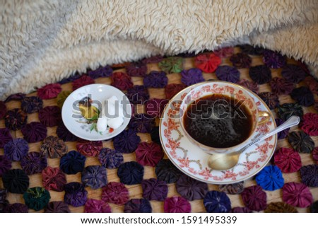 a cup of coffe with a cup of lump sugar #1591495339